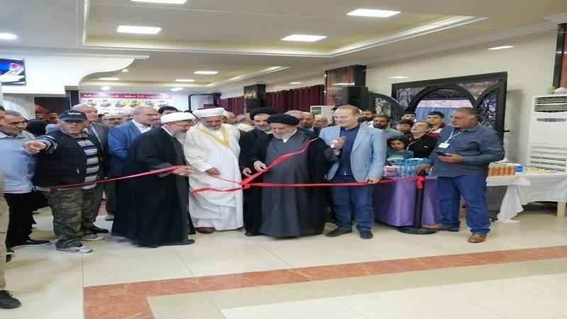 رئيس المجلس السياسي في حزب الله يفتتح معرض صحف في كرك نوح