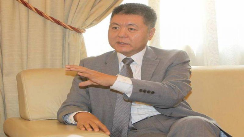 """السفير الصيني لـ""""العهد"""": """"كورونا"""" أثّر على الاقتصاد العالمي.. حالات الشفاء تزداد"""