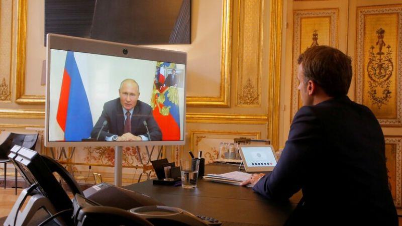 """بوتين وماكرون يدعوان إلى """"وقف عاجل"""" لإطلاق النار في ليبيا"""